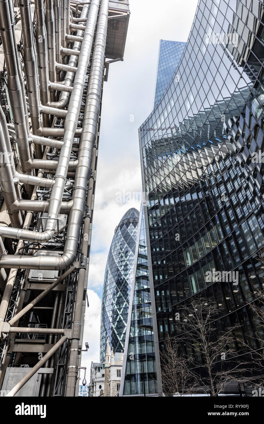 Glass and steel are the materials of choice for the Lloyds of London, 'Gherkin', 'Scalpel', and Willis buildings in the City of London - Stock Image