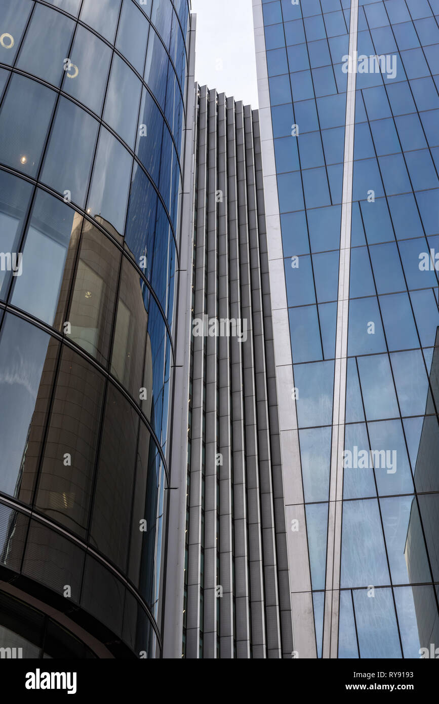 Converging lines: glass towers in the City of London - Stock Image