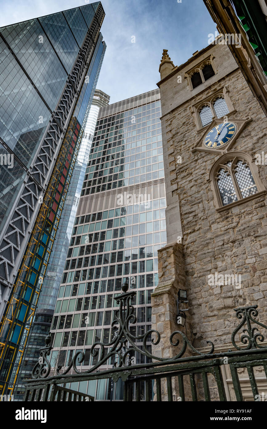 The 13th century St Helen's church Bishopsgate the 'Cheesegrater' Leadenhall Building flanking the St Helen's Building in St Mary Axe - Stock Image