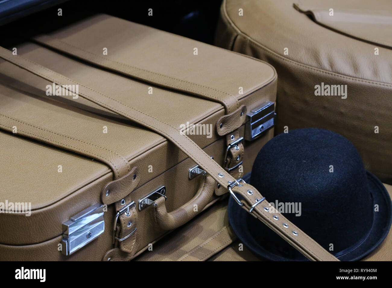 Old leather suitcase in the trunk of a old car - Stock Image