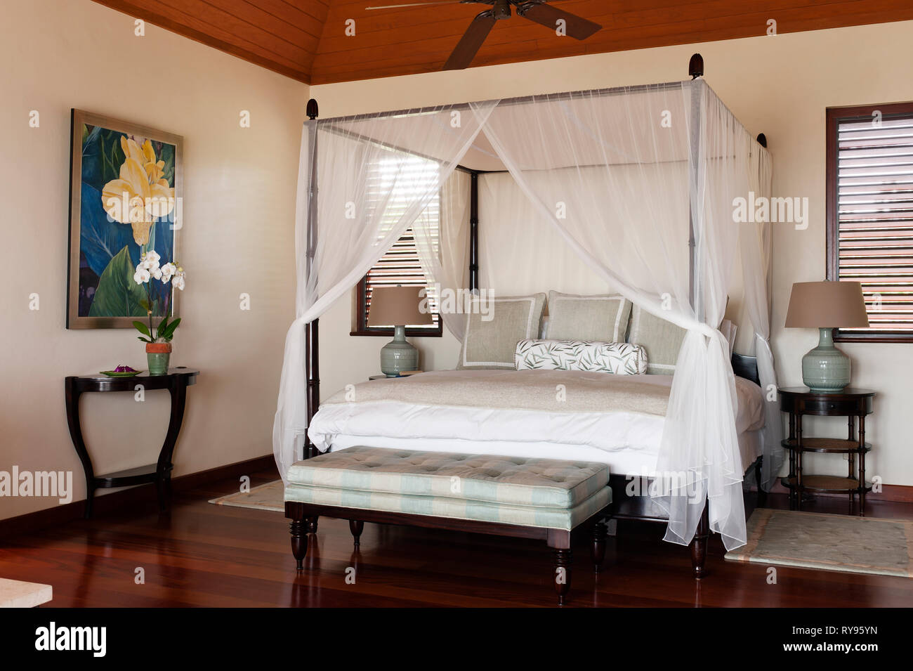Rustic Bedroom With Four Poster Bed In Tamarind Cove Antigua Stock Photo Alamy