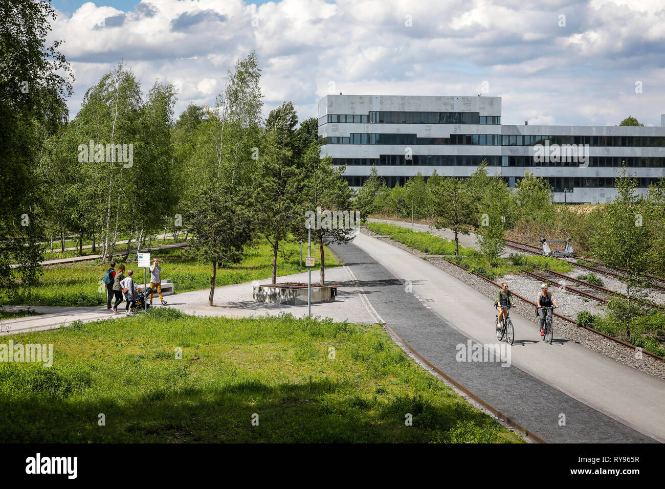 Essen, Ruhr area, North Rhine-Westphalia, Germany - Zollverein Park on the site of the Zollverein colliery, in the background the new Folkwang Univers - Stock Image