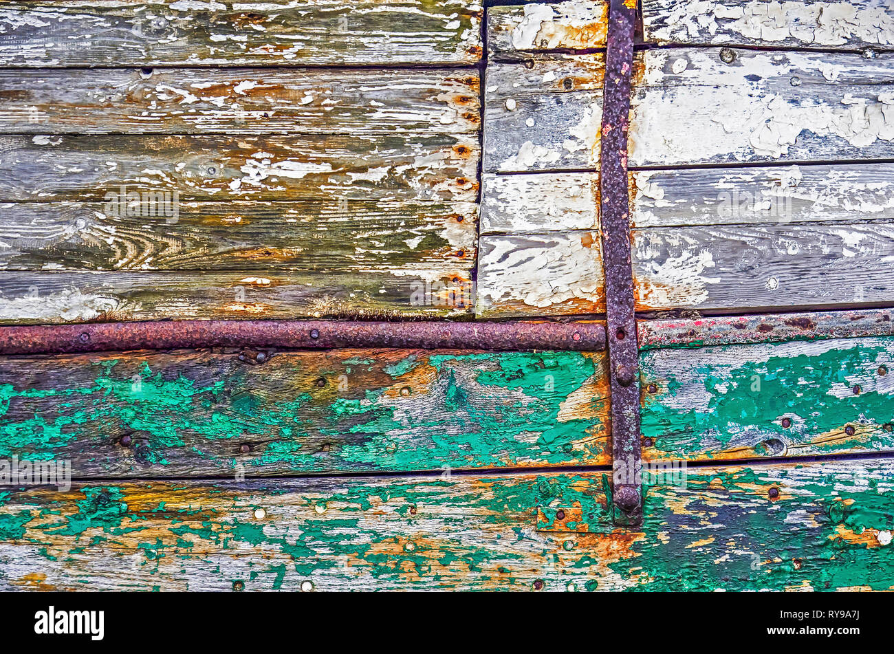 Fragment of a ship hull made of wooden planks and pieces of
