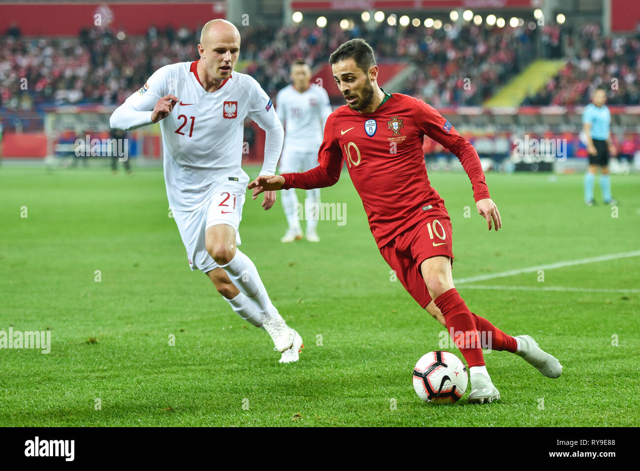 CHORZOW, POLAND - OCTOBER 11, 2018: Football Nations League division A group 3 match Poland vs Portugal 2:3 . In the picture Rafal Kurzawa (L) and Ber - Stock Image
