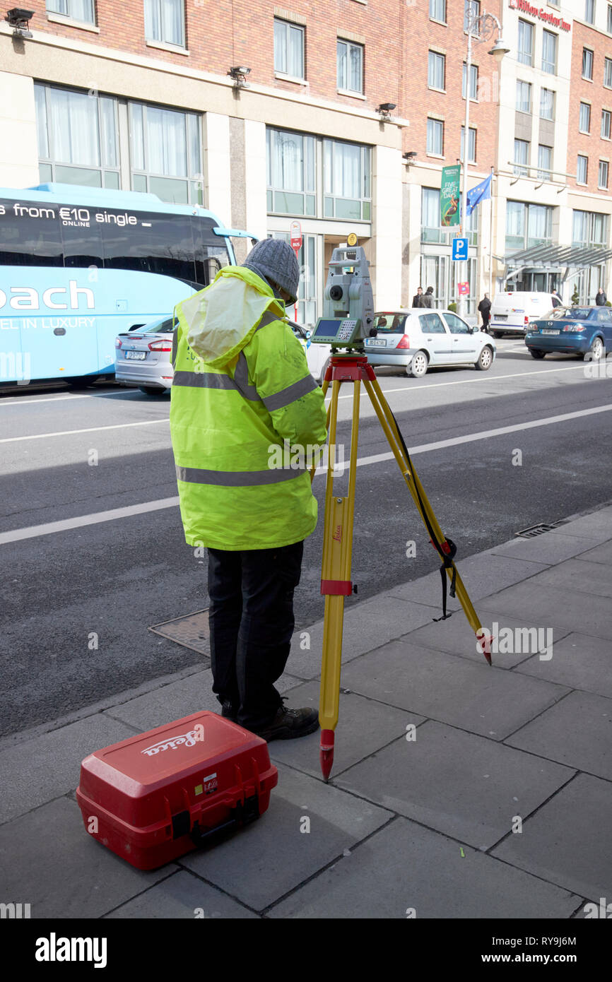Surveyor with leica theodolite Dublin Republic of Ireland Europe - Stock Image