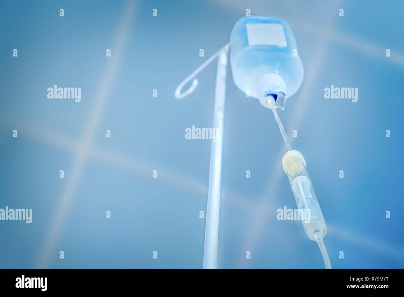 Private medicine. Anesthesia. Traditional medicine. Infusion drip, drop counter in hospital background. Preparing for surgery. Painless concept - Stock Image