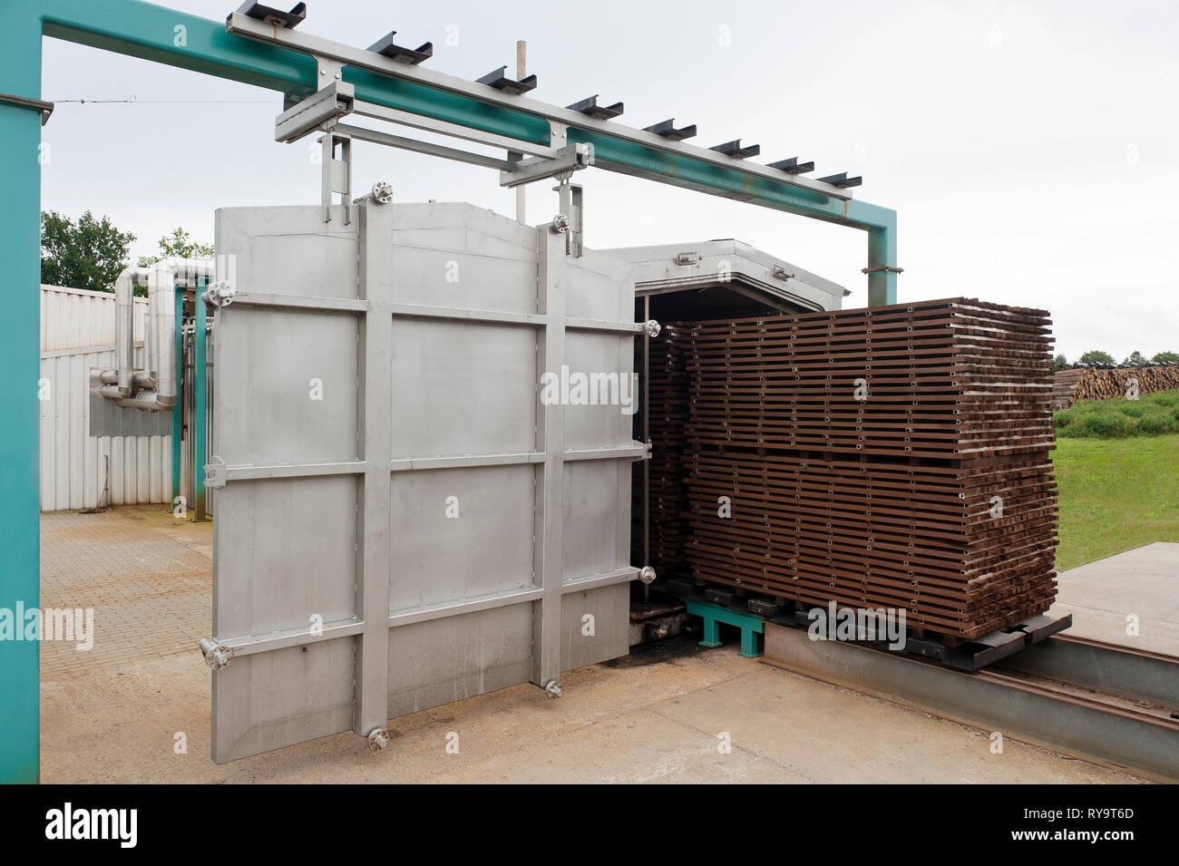 Lumber on conveyor belt in factory - Stock Image