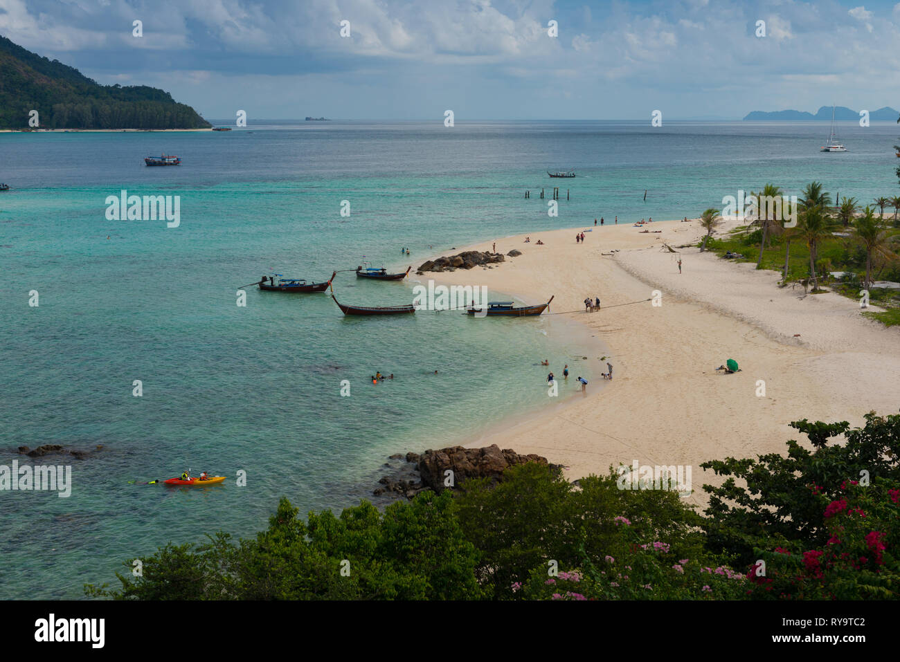 Aerial view of Ko Lipe Sunrise beach with longtail boats and kayaks, Thailand Stock Photo