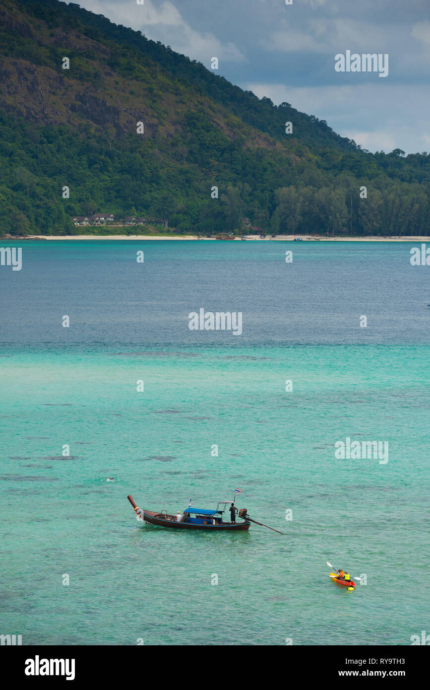 Longtail boat and kayak on Ko Lipe beach, Thailand Stock Photo