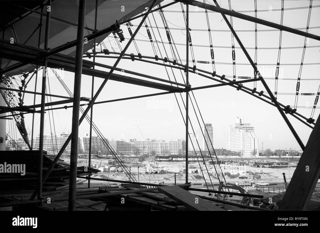 The Munich Olympic Park under construction for the Games 72. View from the Swim Hall to the Village. Blick aus dem Schwimmstadion auf das Olympiadorf - Stock Image