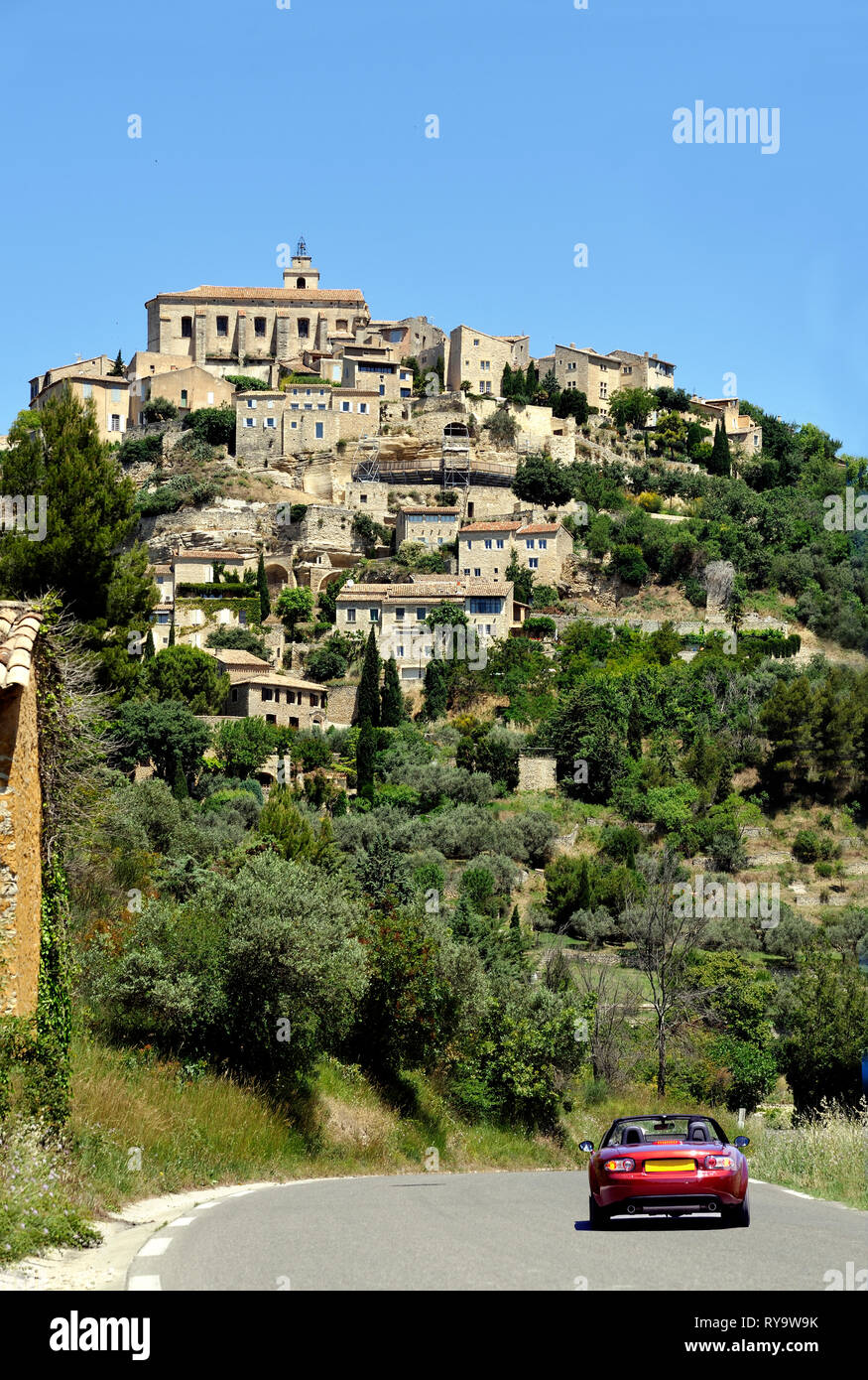 View At Menerbes In The Luberon France With A Sports Car On The Road Leading To The Village Stock Photo Alamy