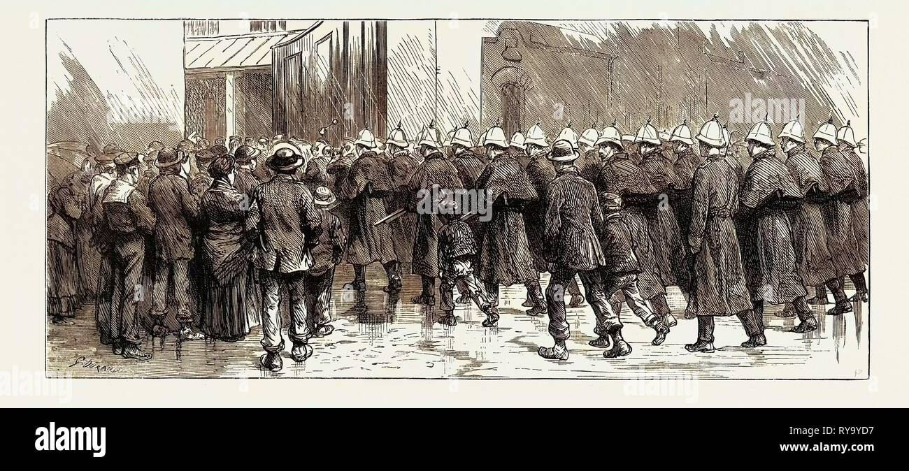 The Rebellion in the Soudan (Sudan) Reinforcements Leaving Portsmouth: The Royal Marine Artillery from Eastney Barracks Entering Portsmouth Dockyard - Stock Image