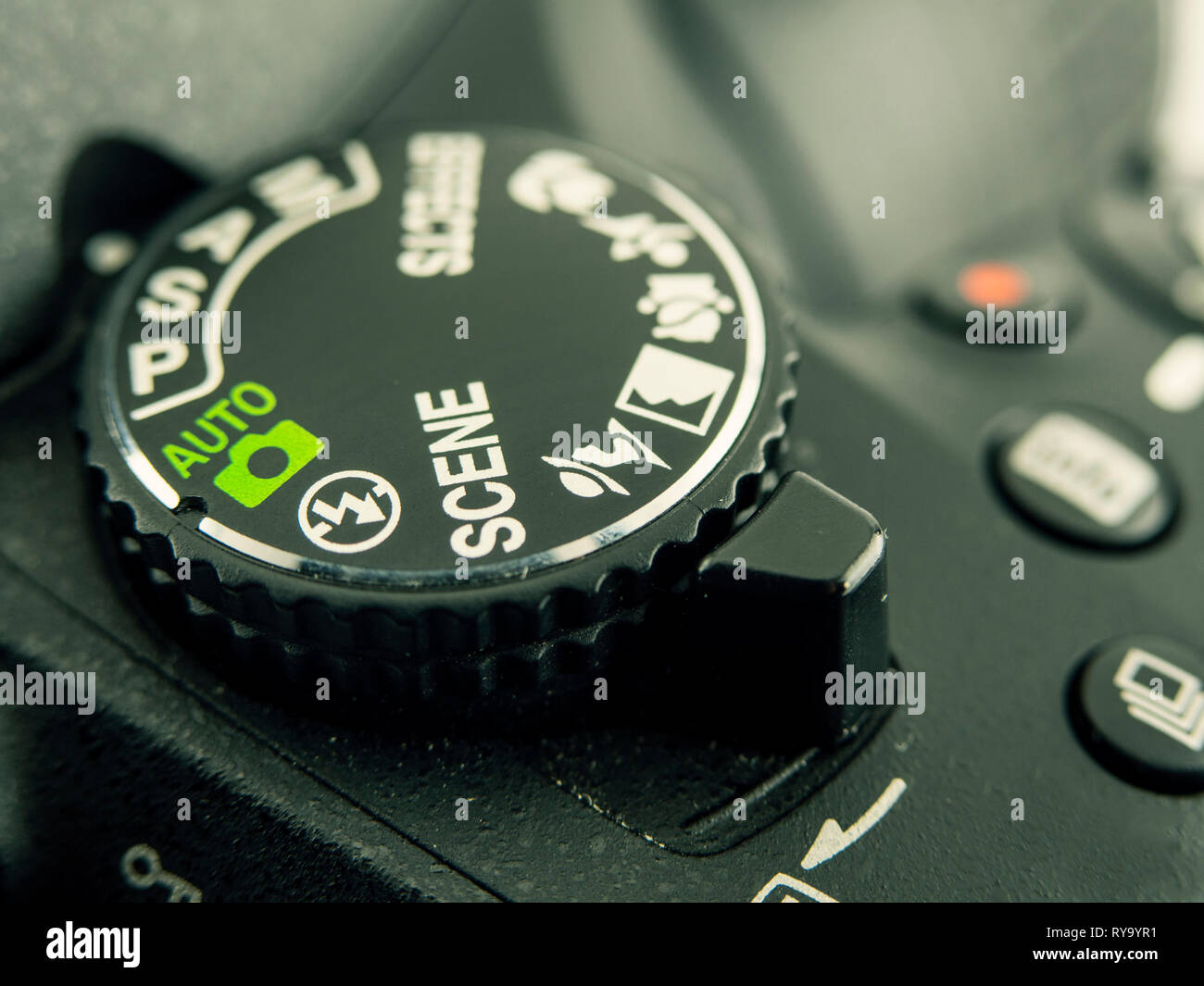 Close-up image of DSLR camera button dial - Stock Image