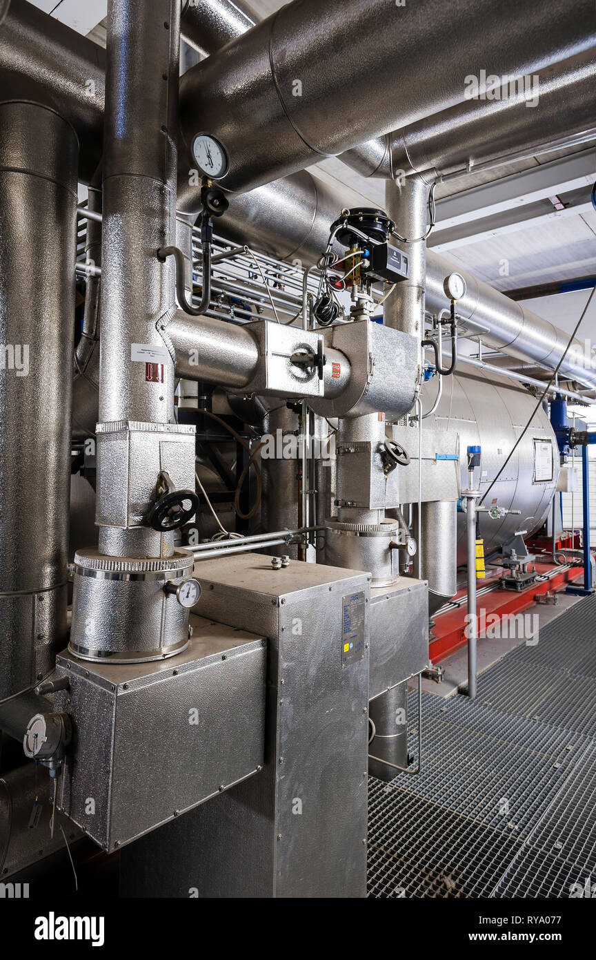 Silver machinery in factory - Stock Image