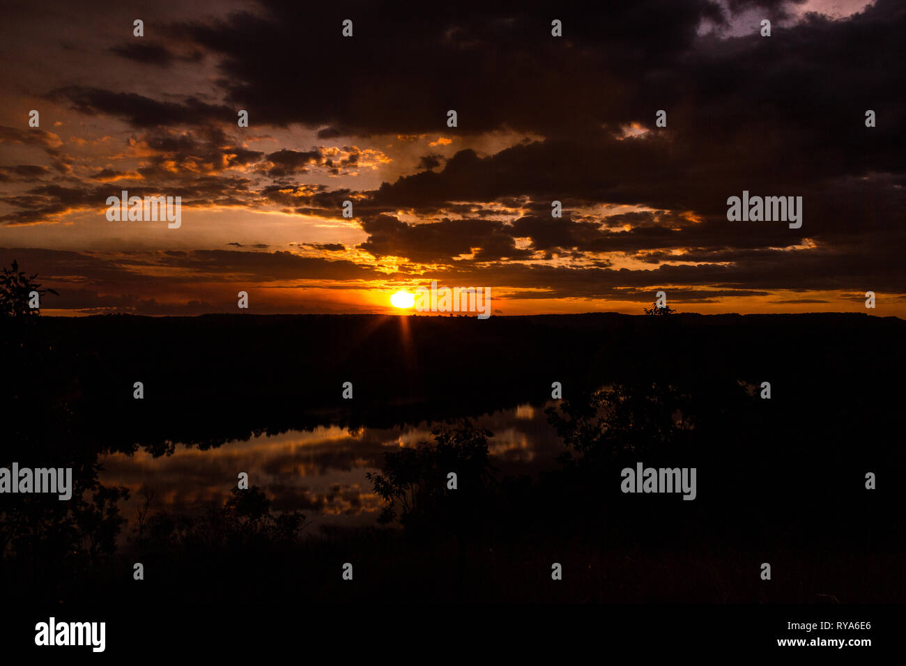 shot of a beautiful sunset in the australian outback with 1 lakes, Nitmiluk National Park, Australia - Stock Image