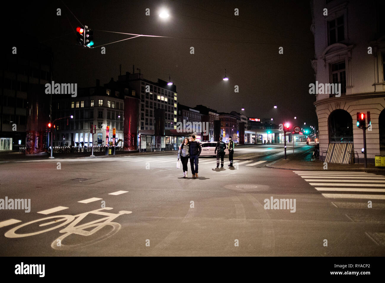 Denmark, Copenhagen - February 15, 2015. Armed Danish police officers patrol the streets at Nørreport in central Copenhagen after the terror attacks on Saturday. Later Sunday morning the shooting suspect was shot dead around 04.50 AM at Svanevej. (Photo credit: Kenneth Nguyen - Gonzales Photo). Stock Photo