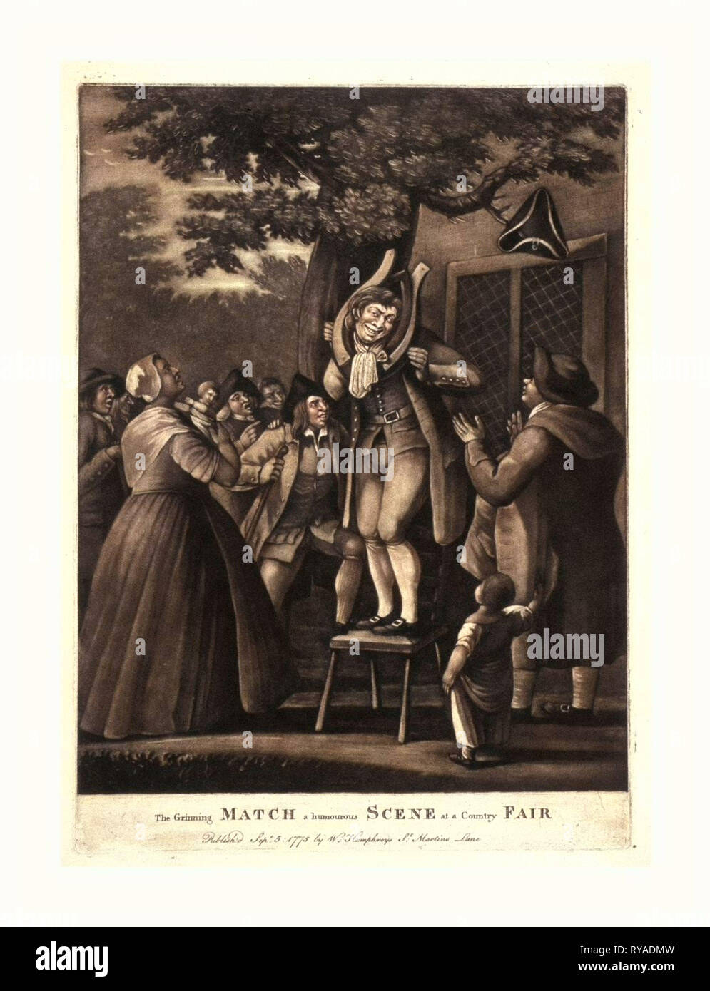 The Grinning Match, a Humourous Scene at a Country Fair, Engraving 1775, Mezzotint., a Man Stands on a Chair Beneath a Large, Spreading Tree on which a Tri-Corn Hat Hangs from a Limb, His Grinning Face Framed by a Horse-Collar, a Woman and a Man Look on in the Foreground, the Man Applauds, While a Crowd of Countrymen on the Left, in the Rear, Encourage Him with Laughter and Applause, with Building on the Right, in the Background - Stock Image