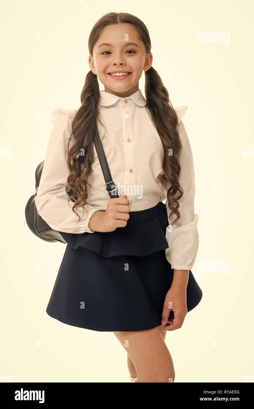Learn how fit backpack correctly for school. Schoolgirl cute in formal uniform wear backpack. School backpack concept. Follow these tips. Right and wr - Stock Image