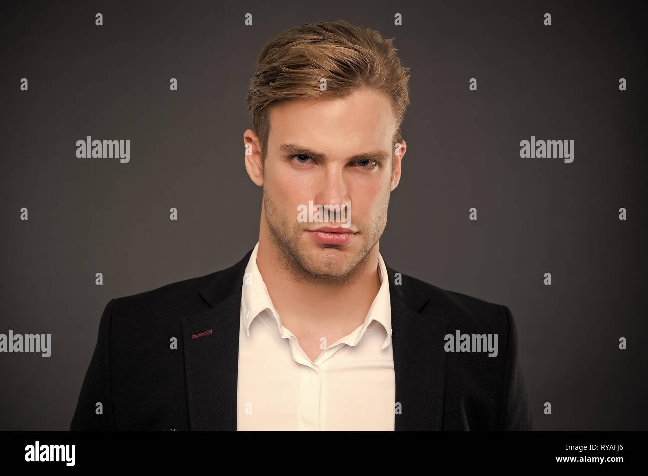 Taking life seriously. Man with bristle on unshaven face. Handsome businessman in formal wear. Barbershop salon and male beauty. Face of plenary leade - Stock Image