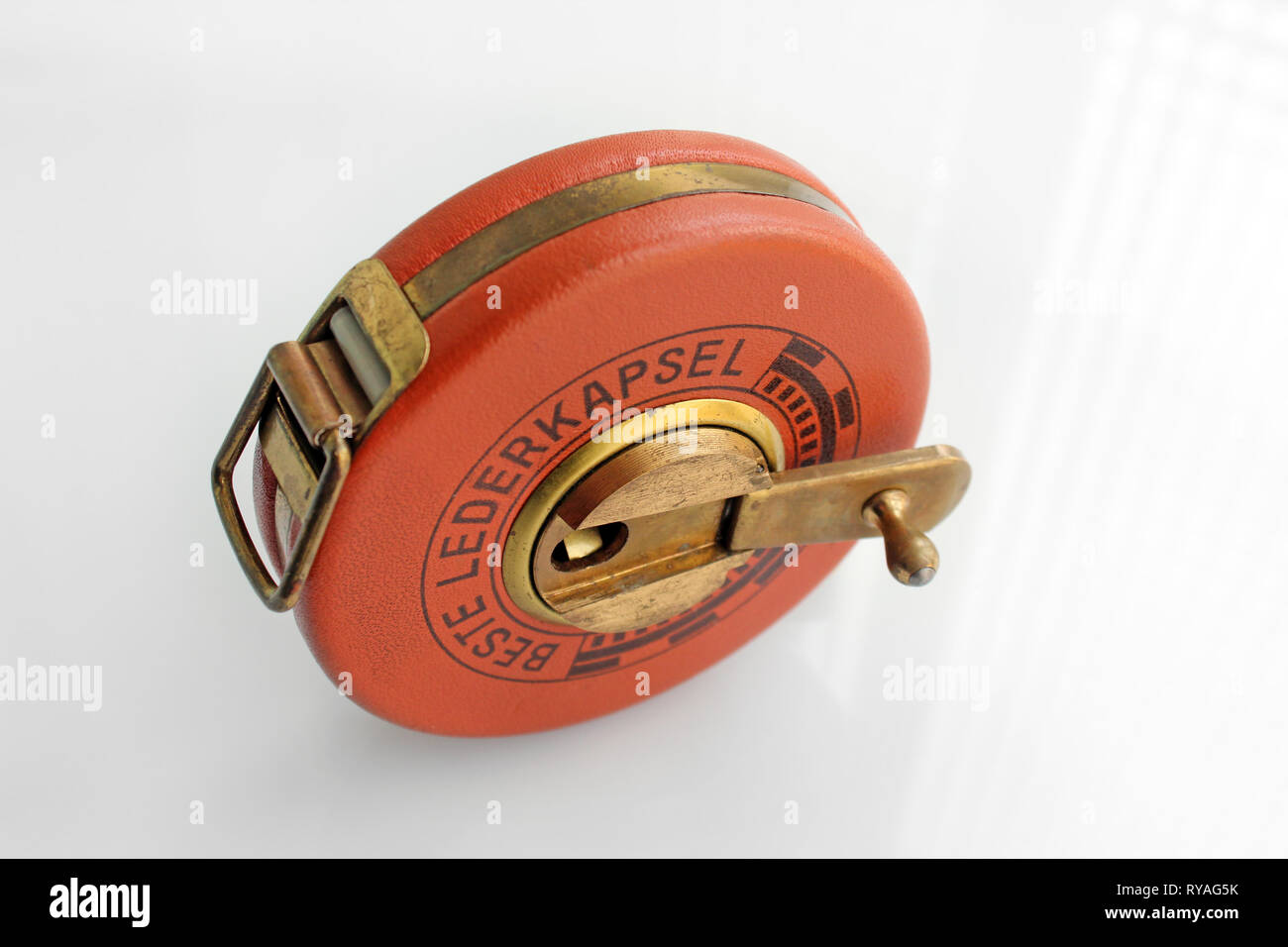 Old german roll measuring tape, isolated on white background, close-up - Stock Image