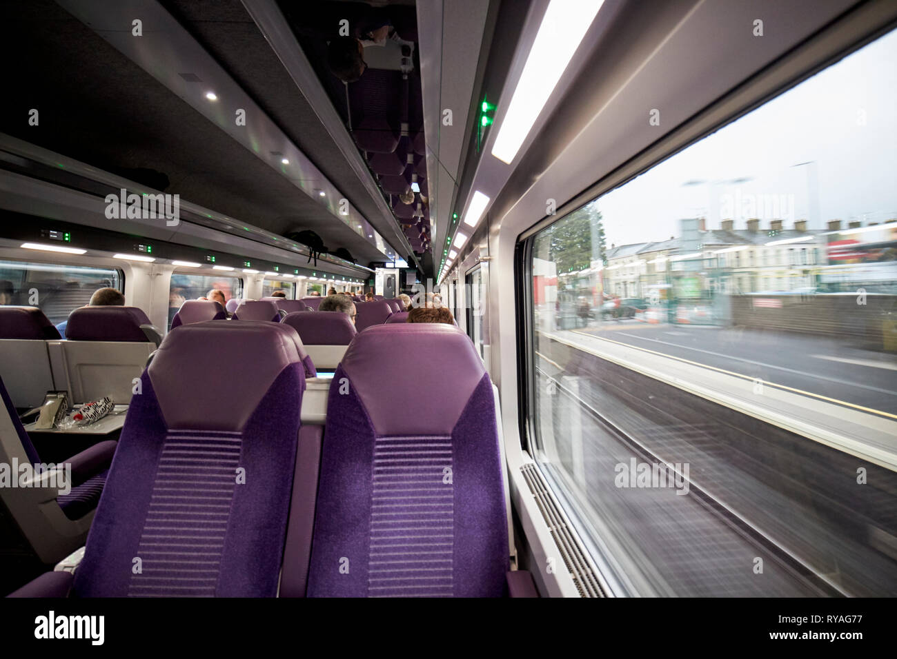 empty seat on enterprise train between Belfast and Dublin passing through station in northern ireland - Stock Image