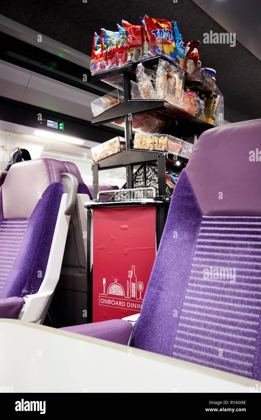 food trolley cart on enterprise train between Belfast and Dublin by northern ireland railways and irish rail - Stock Image