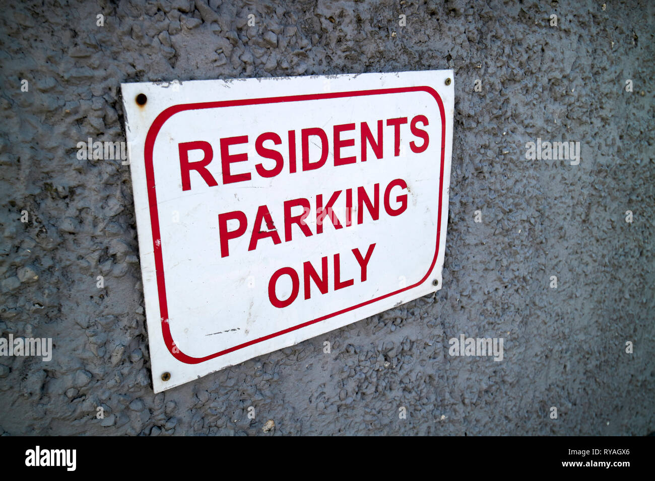 residents parking only sign on a garden wall Dublin Republic of Ireland Europe - Stock Image