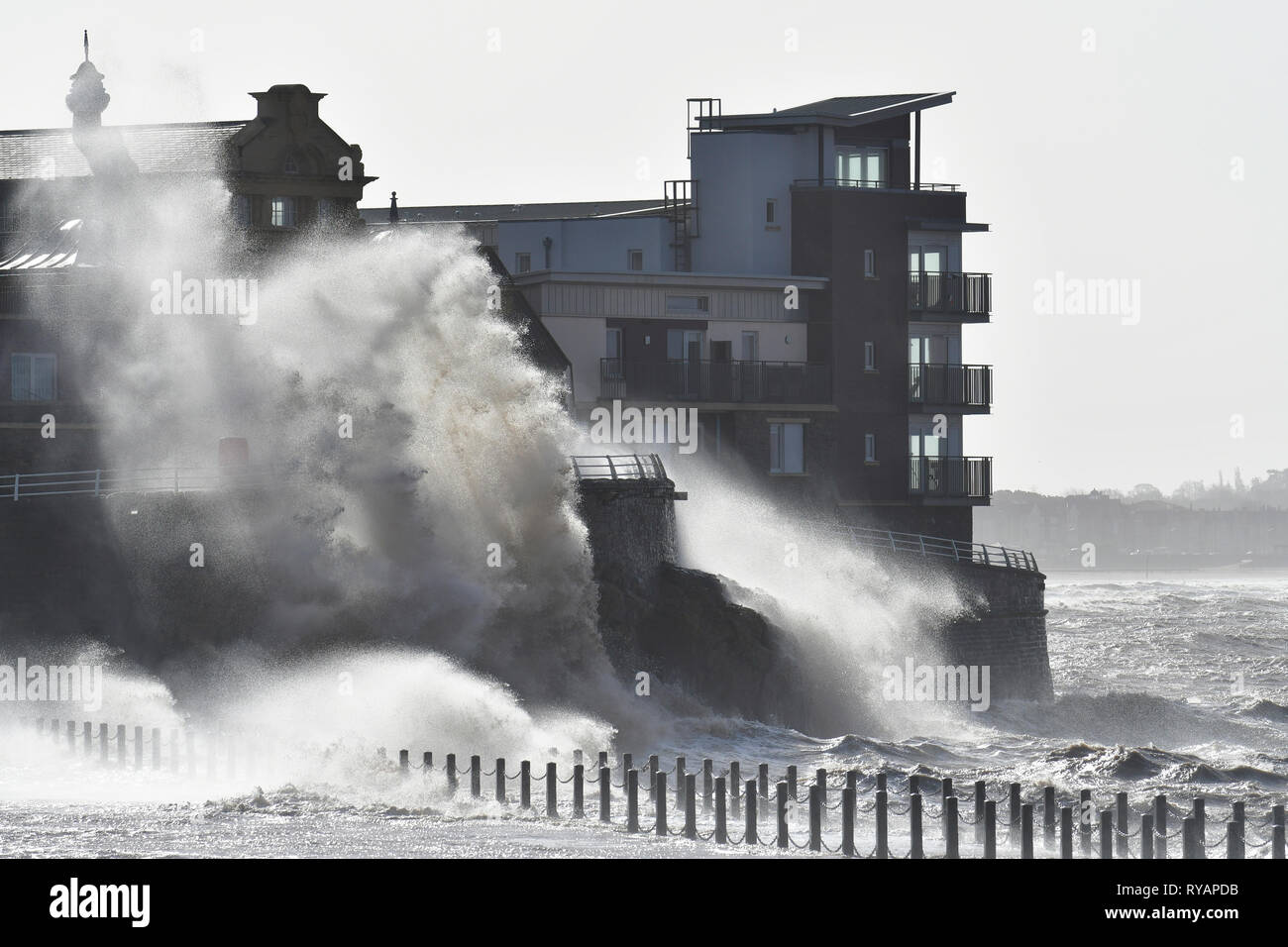 Weston Super Mare, UK. 13th Mar, 2019. UK Weather.Storm Gareth with large waves Batters the Marine Lakes at Weston Super Mare in North Somerset . Credit: Robert Timoney/Alamy Live News - Stock Image