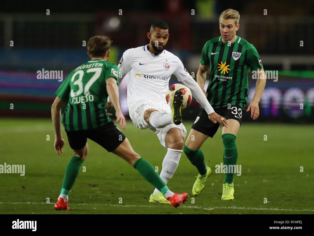 firo: 12.03.2019, Football, 2018/2019, 3.Bundesliga SC Preussen, Prussia Muenster Munster - Hansa Rostock 0: 1 duels, Cebio Soukou | usage worldwide - Stock Image