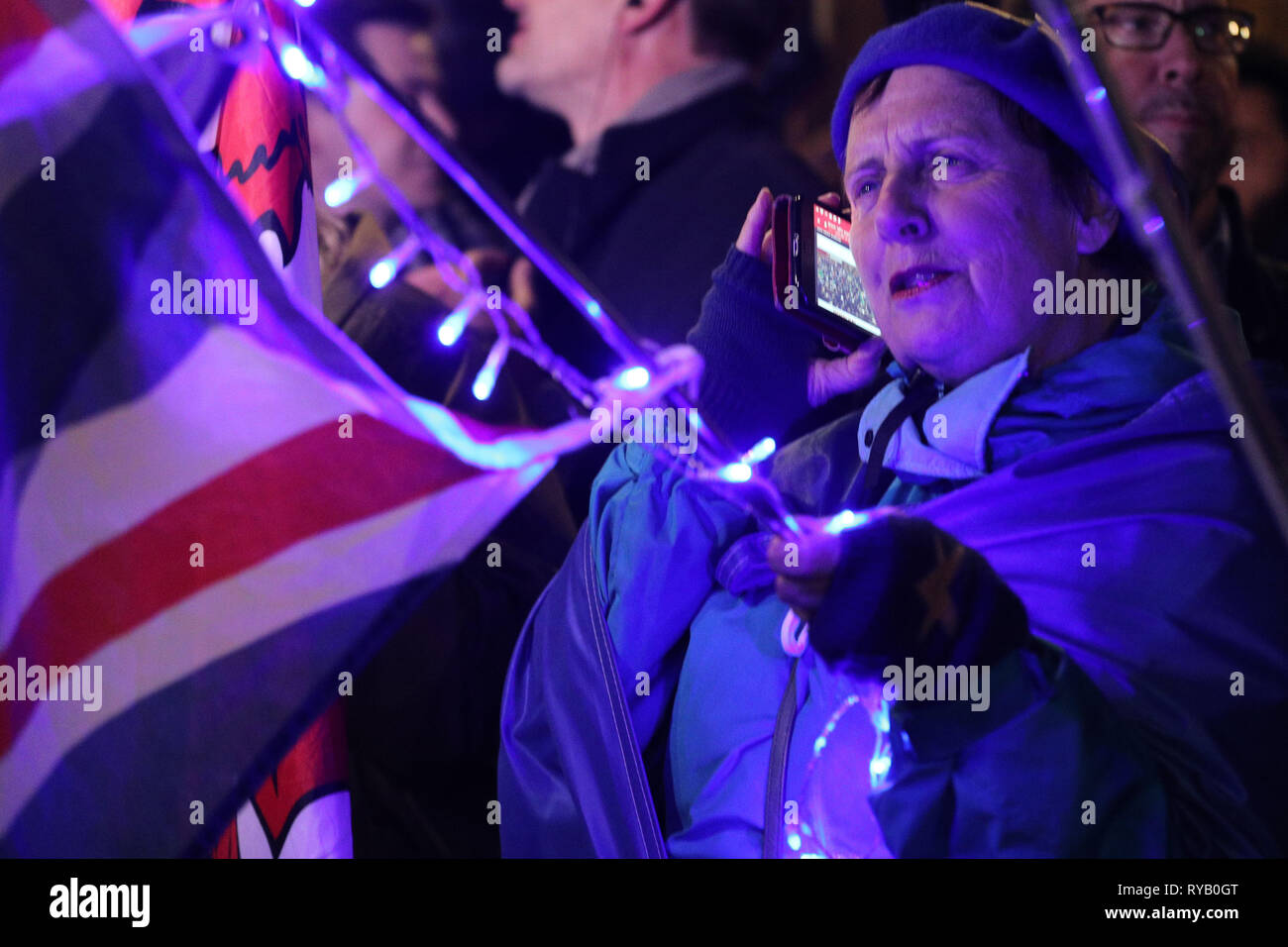 Westminster, London, UK. 13th Mar, 2019. Remainers eagerly await the results of the no-deal Brexit vote in Parliament, and celebrate and cheer outside the Houses of Parilament as news breaks that the no deal has been voted down. Credit: Imageplotter/Alamy Live News - Stock Image