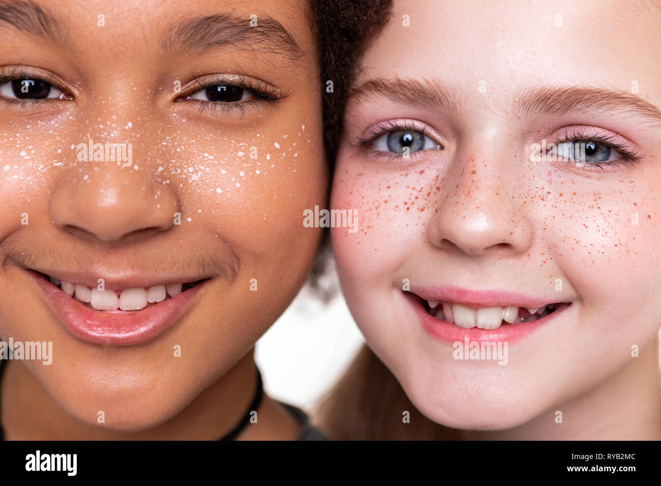 Good-looking flawless kids looking completely different while posing - Stock Image