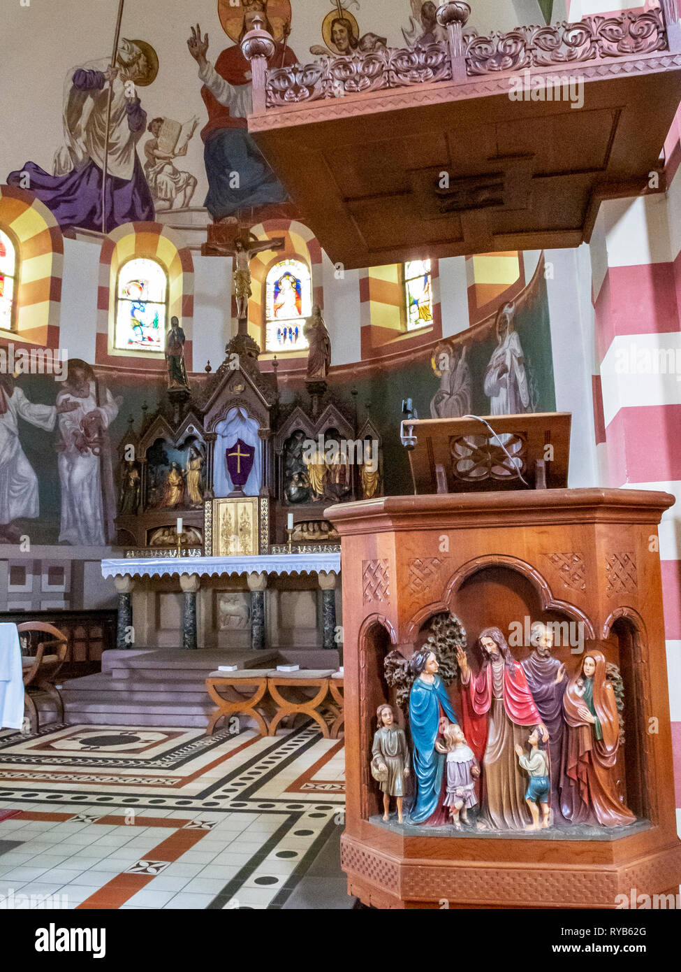 BIERSDORF AM SEE, GERMANY - MARCH 22, 2015: Close picture of the Neo-Romanesque pulpit of St. Martin's Church, the choir with the high altar in the ba Stock Photo