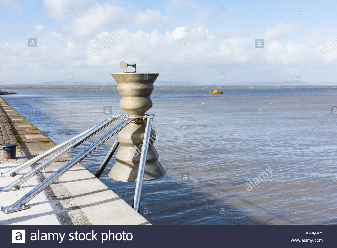 A Time and Tide Bell on the Stone Jetty in Morecambe, Lancashire, UK