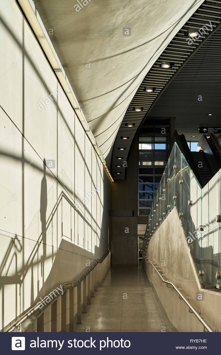 Sunlit stairway leading to lower level platforms. York University Subway Station, Toronto, Canada. Architect: Foster + Partners, 2018. - Stock Image
