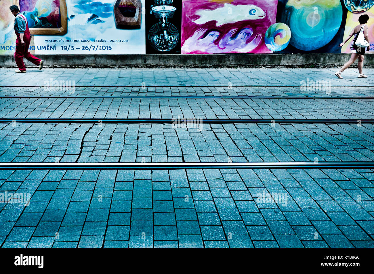 man and woman walking in opposite directions - Stock Image