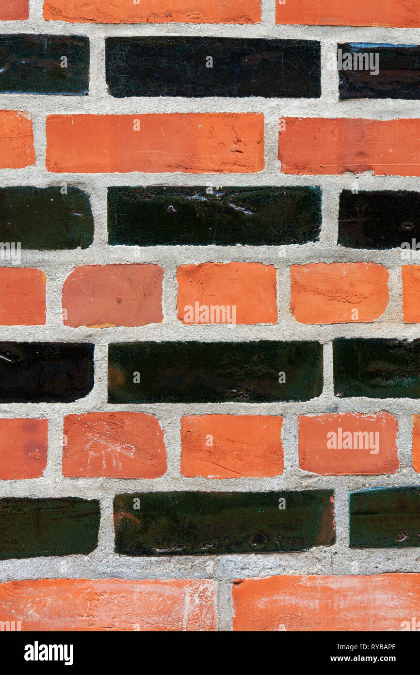 Close-up of brickwork / masonry of the Brick Gothic city hall in the Hanseatic town Lübeck / Luebeck, Schleswig-Holstein, Germany - Stock Image