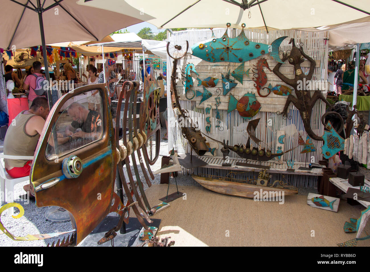 IBIZA, SPAIN - JUNE 24, 2016: Crowd of people and tourists, buying in the small Hippy market of Las Dalias in Ibiza - Stock Image