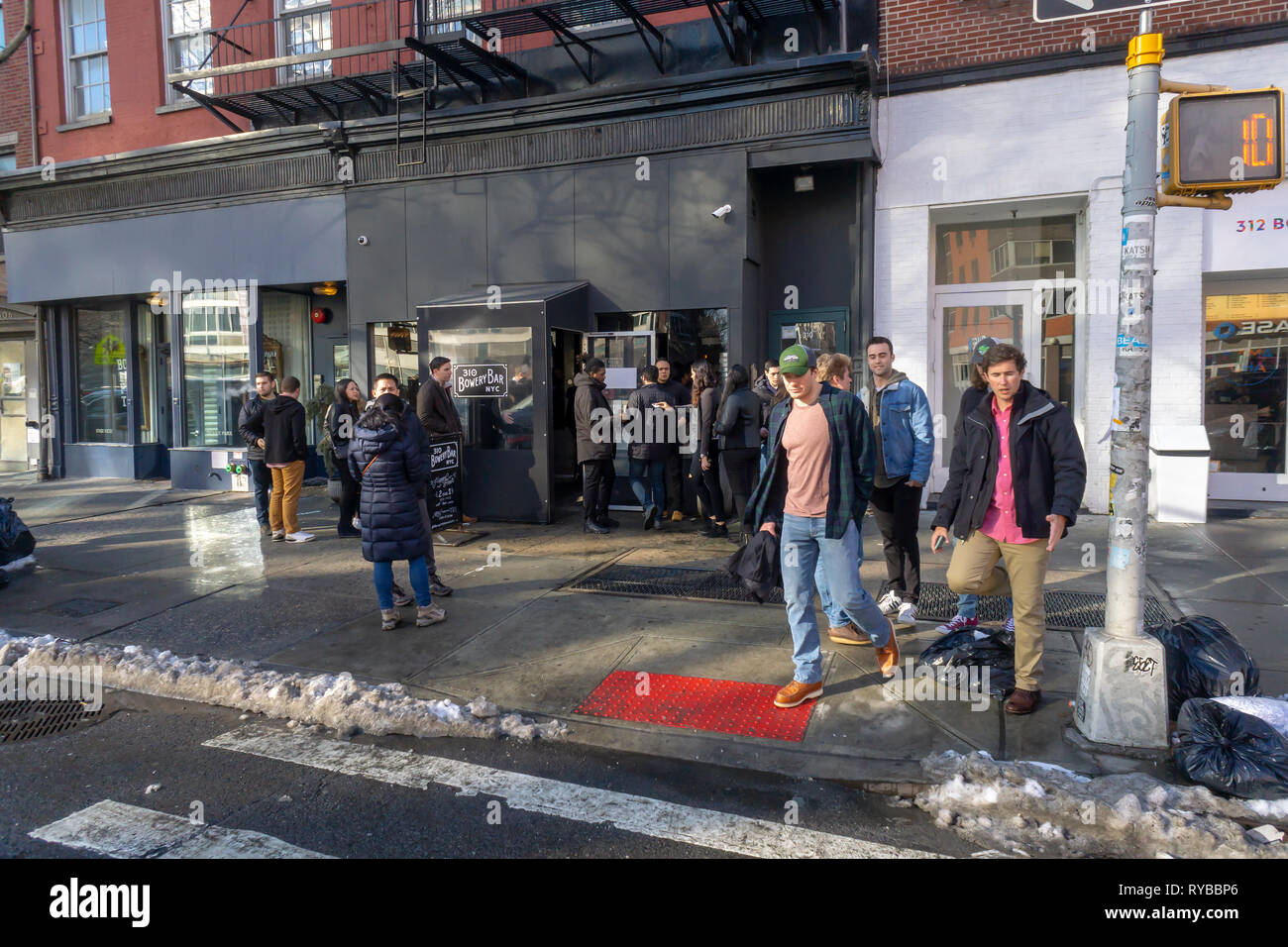 Brunchers queue up to have their ID checked outside the Bowery Bar in New York on Saturday, March 2, 2019. (© Richard B. Levine) - Stock Image