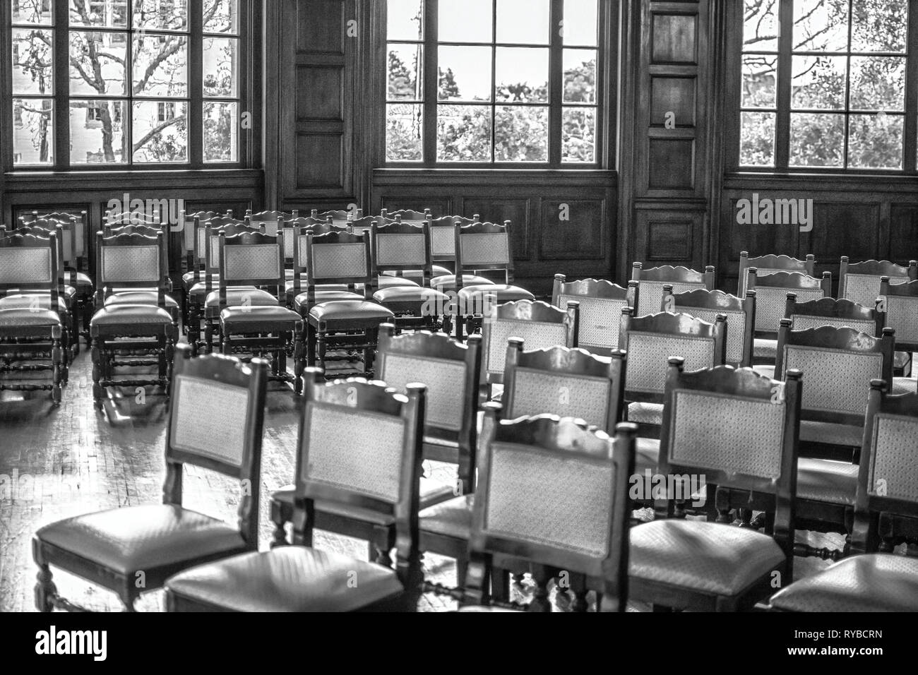 A large grouping of vintage chairs; Ebell Women's Club, Los Angeles, CA USA - Stock Image