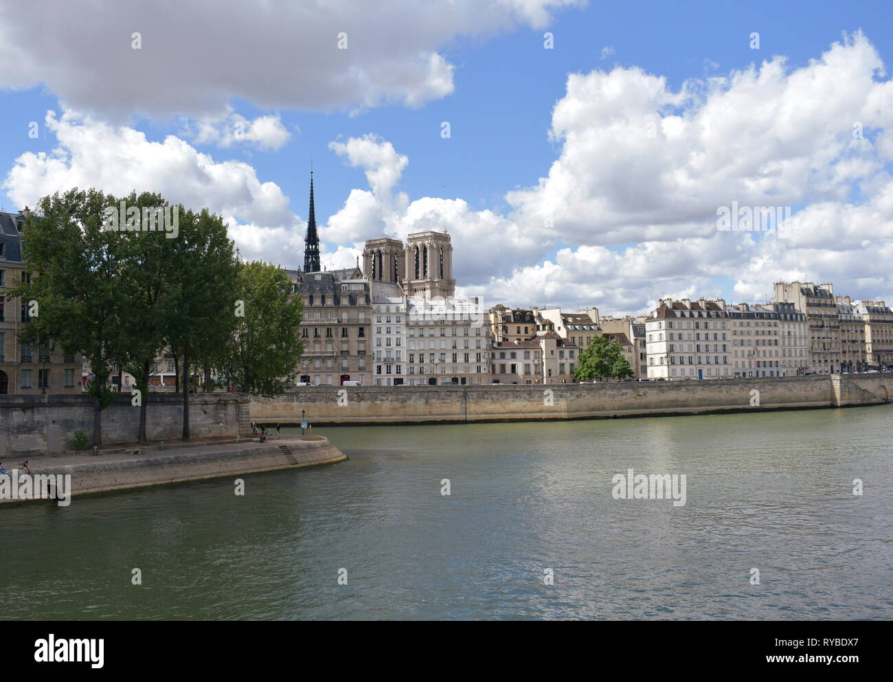 Notre Dame towers and spire from a Seine River bridge, Pont Louis Philippe. Paris, France, 10 Aug 2018. - Stock Image