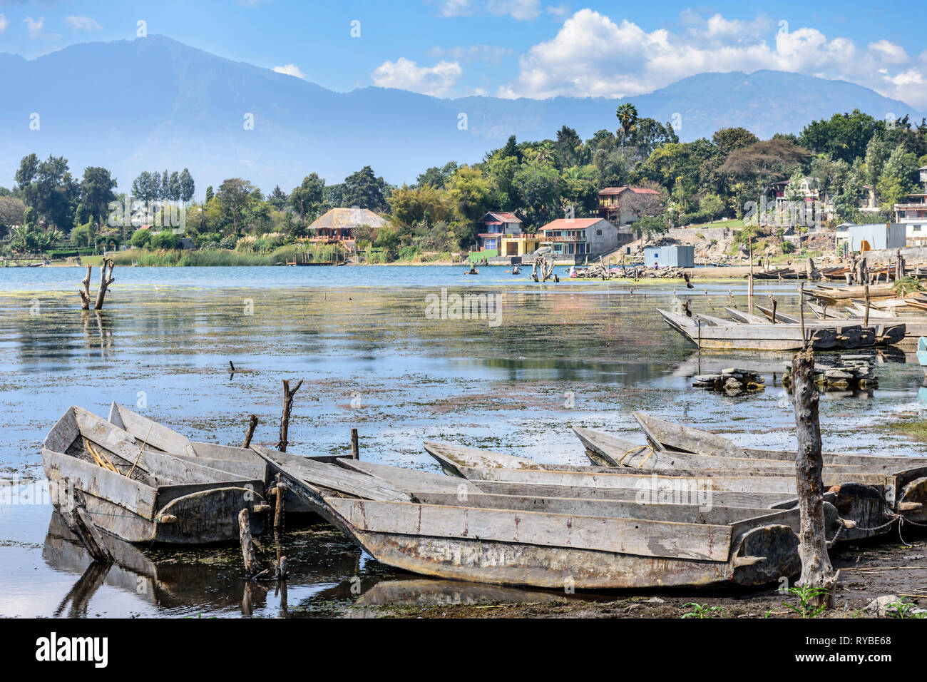 Santiago Atitlan, Lake Atitlan, Guatemala - March 8, 2019: Rows of lakeside traditional canoes by lake in largest lakeside town - Stock Image