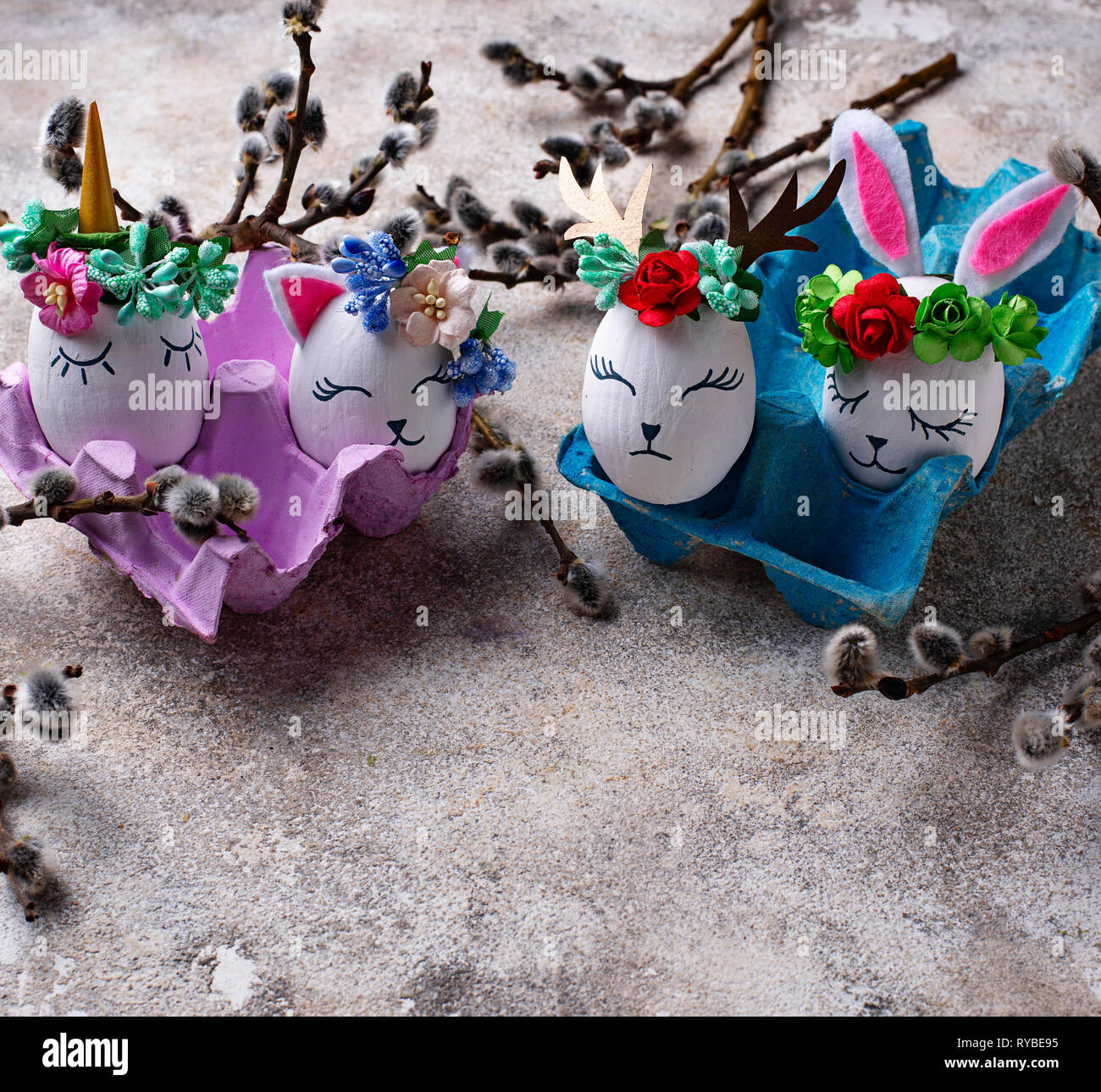 Easter eggs in shape of bunny, cat and deer - Stock Image