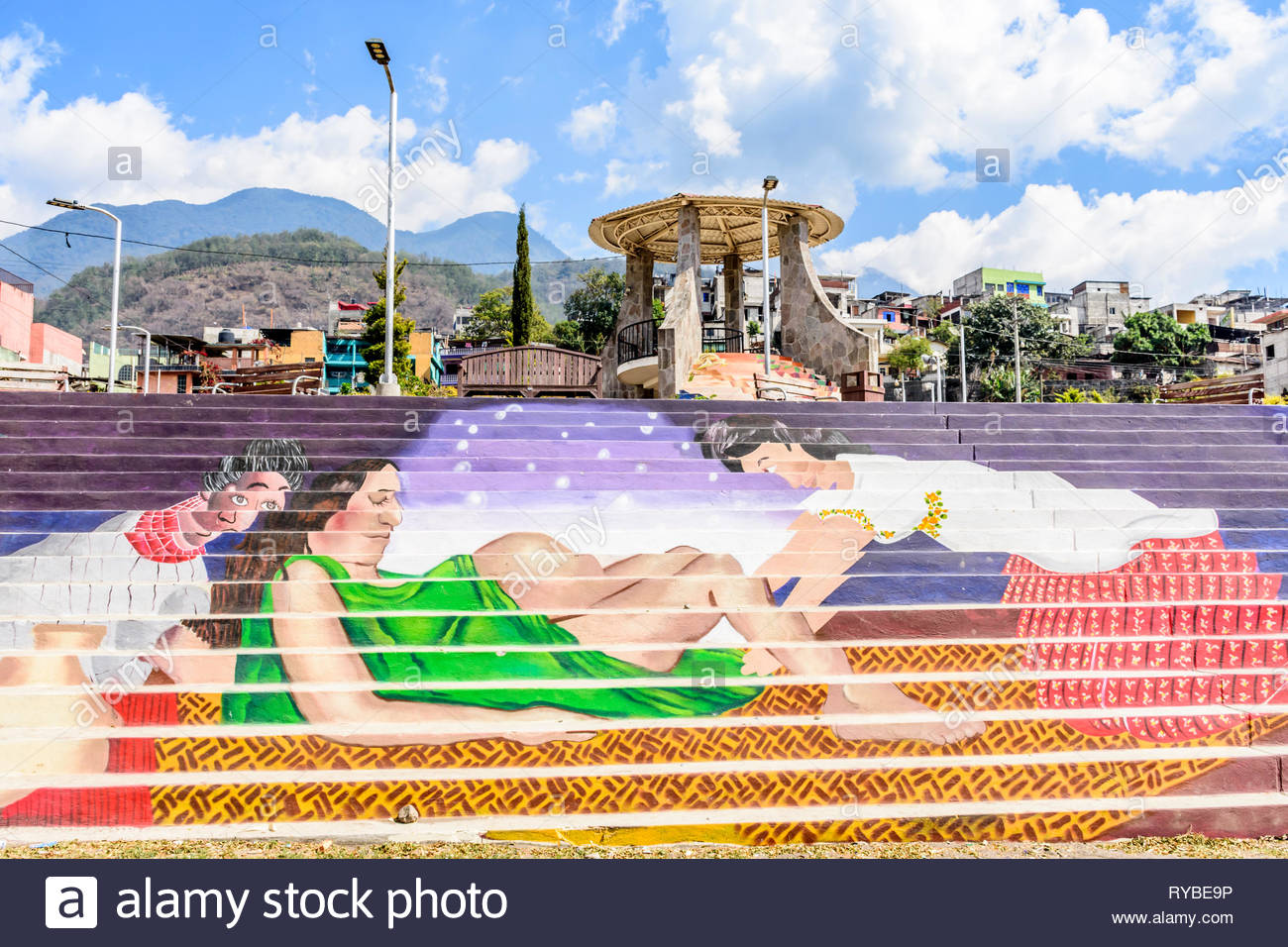 Santiago Atitlan, Lake Atitlan, Guatemala - March 8, 2019: Colorful mural of woman in childbirth by public park in largest lakeside town - Stock Image
