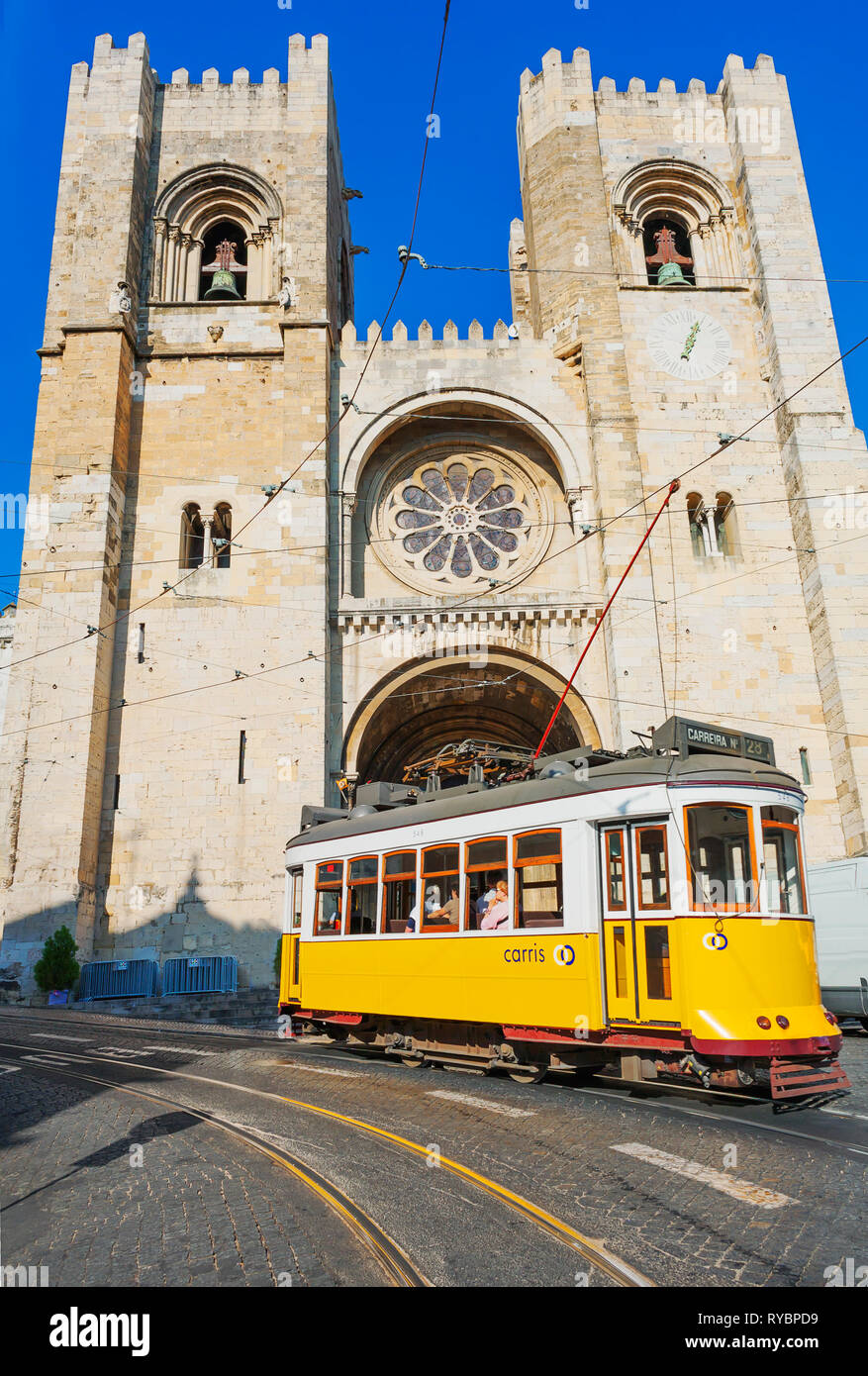 Eletrico (electric tram) in front of the Se Cathedral, Lisbon, Portugal, Europe - Stock Image