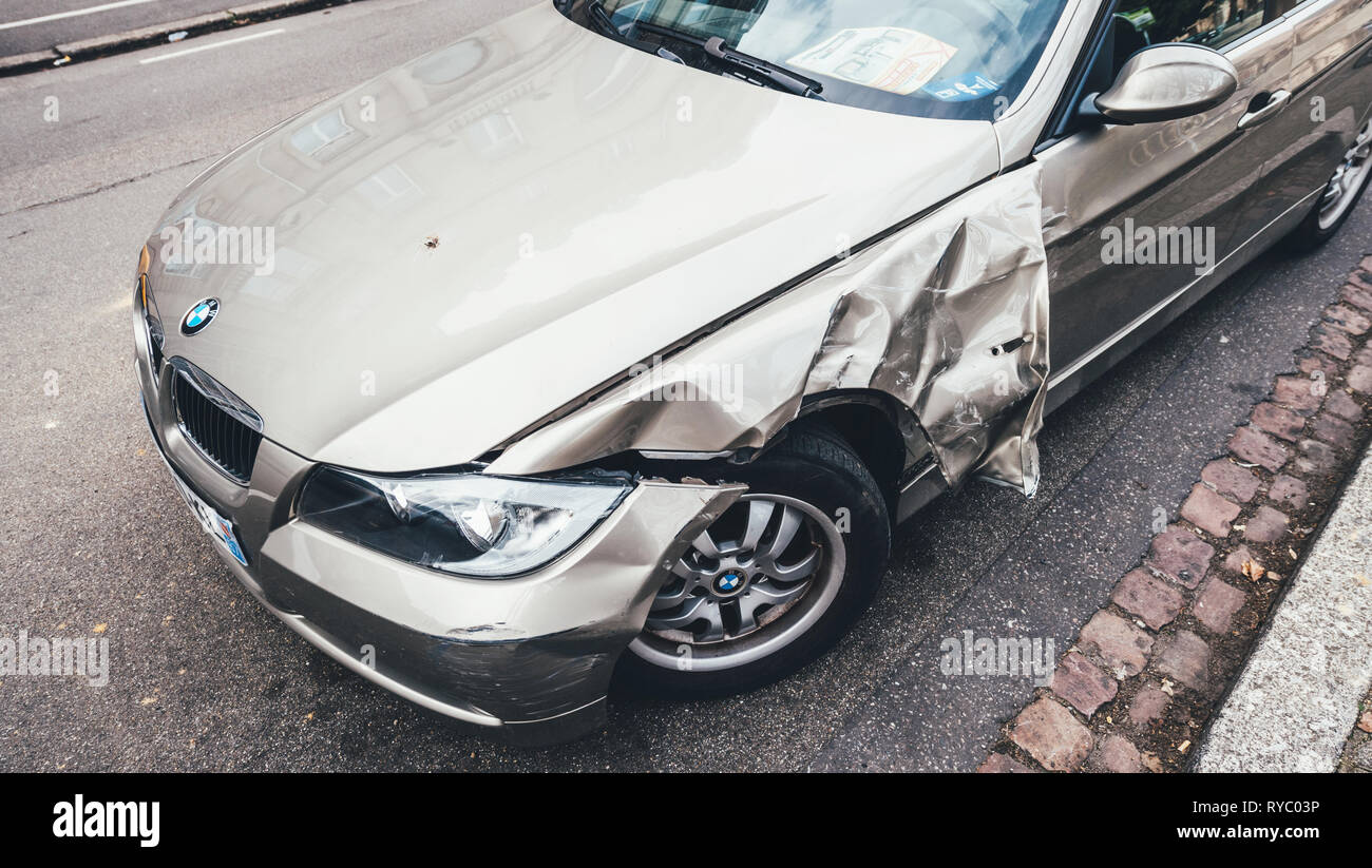Strasbourg, France - Mar 12, 2019: Above view of luxury BMW german car parked on city street with damaged front by accident on the road - Stock Image