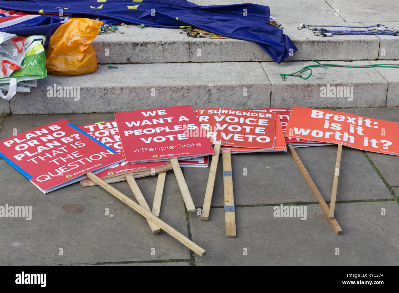 protest signs on the floor with Brexit flag Stock Photo