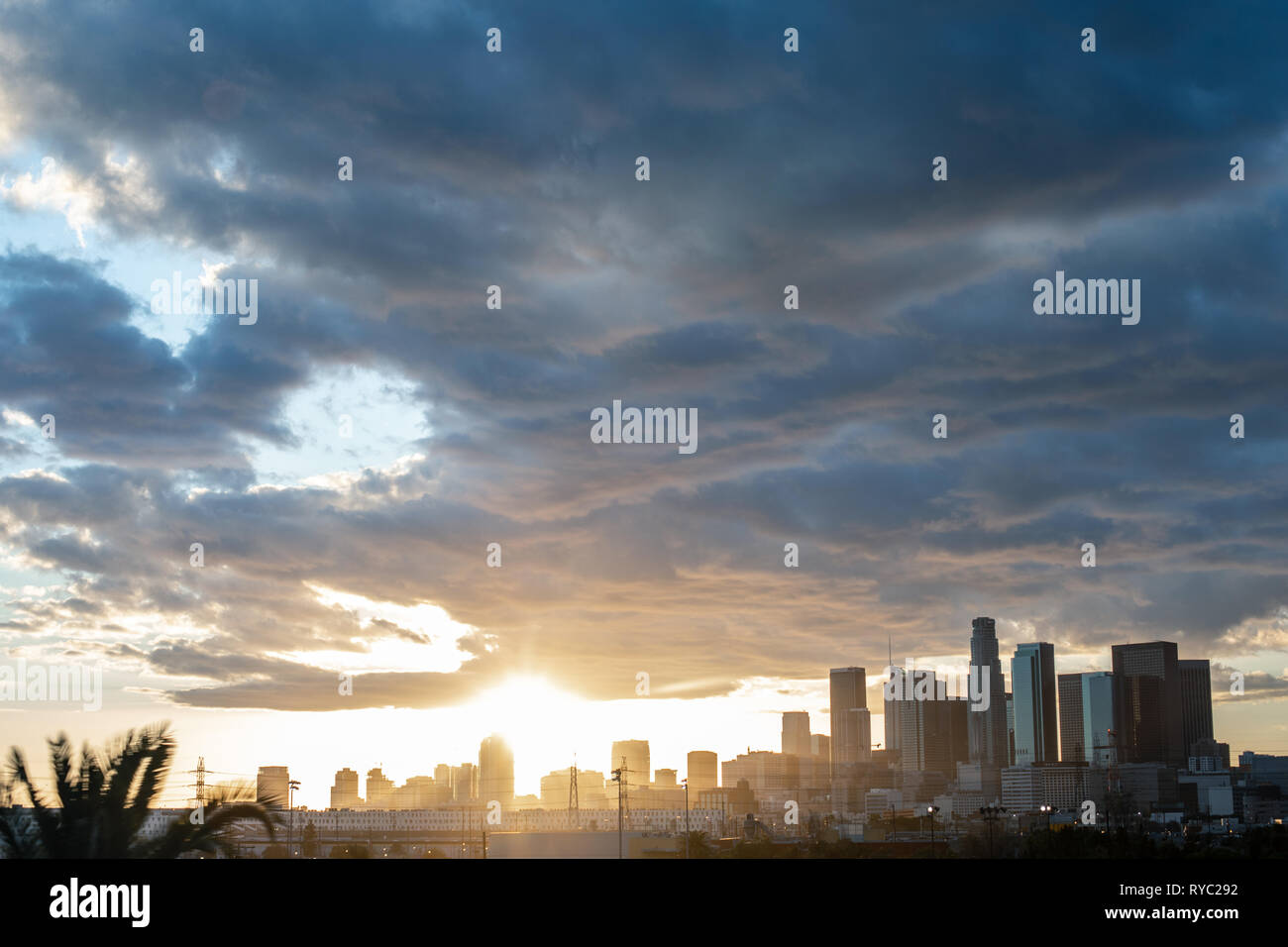 Gorgeous panoramic view of DTLA downtown Los Angeles with the sun setting behind skyscrapers - Stock Image