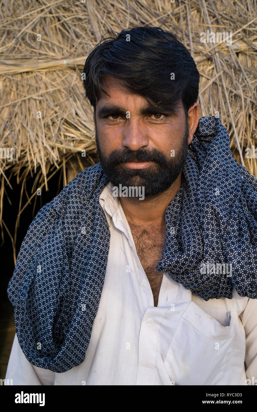 Pakistani man standing outdoors looking at camera - Stock Image