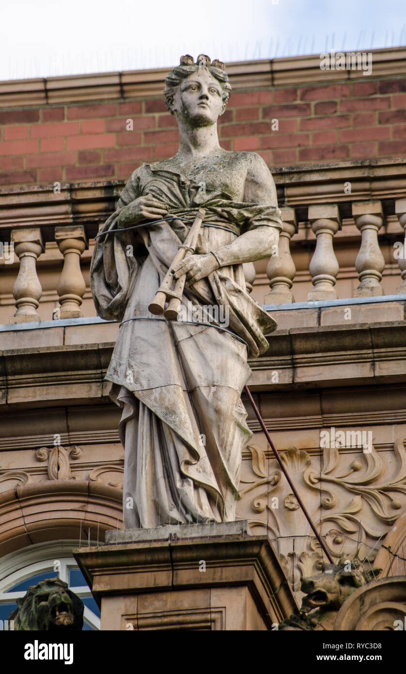 Victorian statue of the Greek Muse of music Euterpe on the exterior of Richmond Theatre.  The building was designed by Frank Matcham and opened in 189 - Stock Image