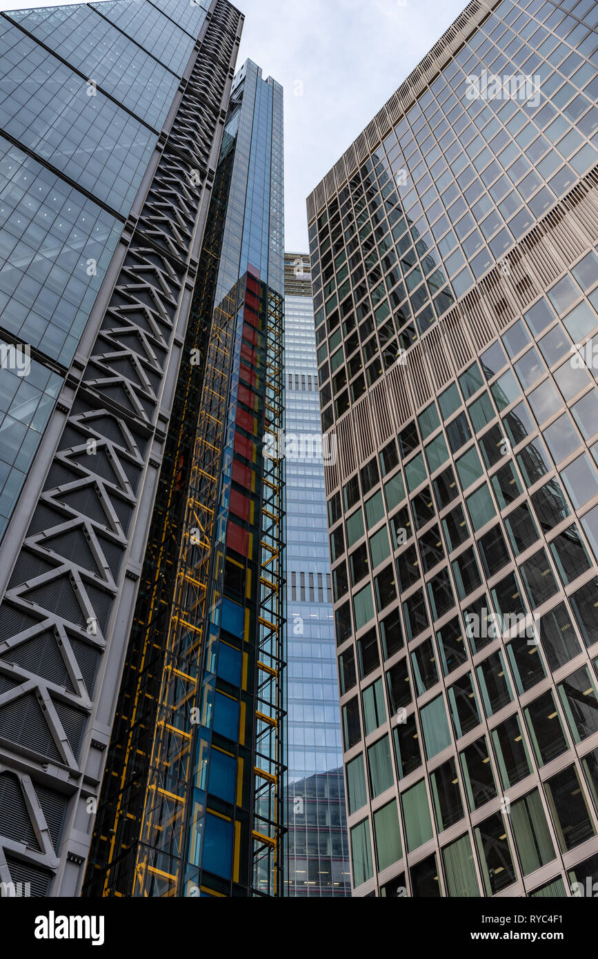 A splash of colour amongst the steel and glass of the 'Cheesegrater', 100 Bishopsgate and St Helen's buildings in St Mary Axe. - Stock Image